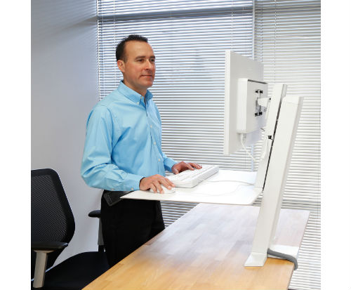 ERgotron Workfit-SR Sit to Stand Desk in use Standing