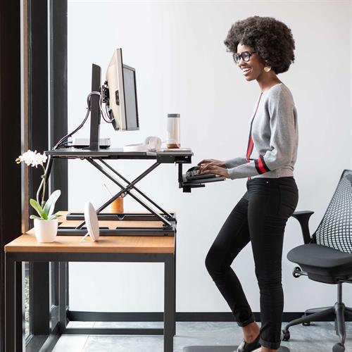 Ergotron WorkFit-TX Standing Desk Converter Standing Side View Office
